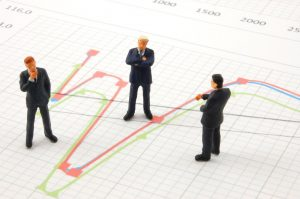 business peoples on economic chart background talking